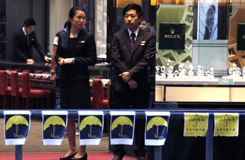 Sales persons wait for customers at a jewelry store at a road occupied by pro-democracy protesters at Mongkok shopping district in Hong Kong